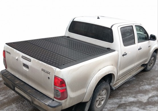 Жесткая четырехсекционная крышка Toyota Hilux VII Vigo